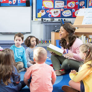 Daycare teacher reading to children