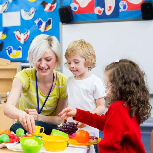 Children and daycare teacher having fun