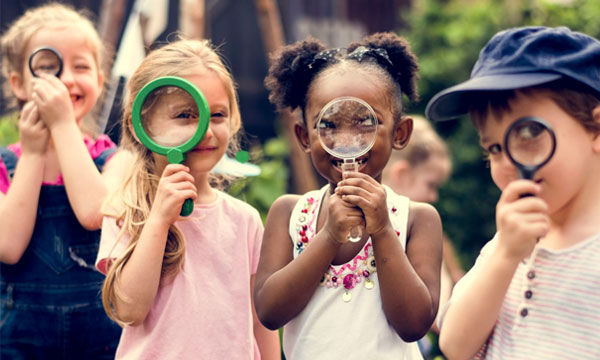 Kids playing with magnifying glasses